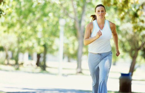 portrait of a mid adult woman jogging in a park